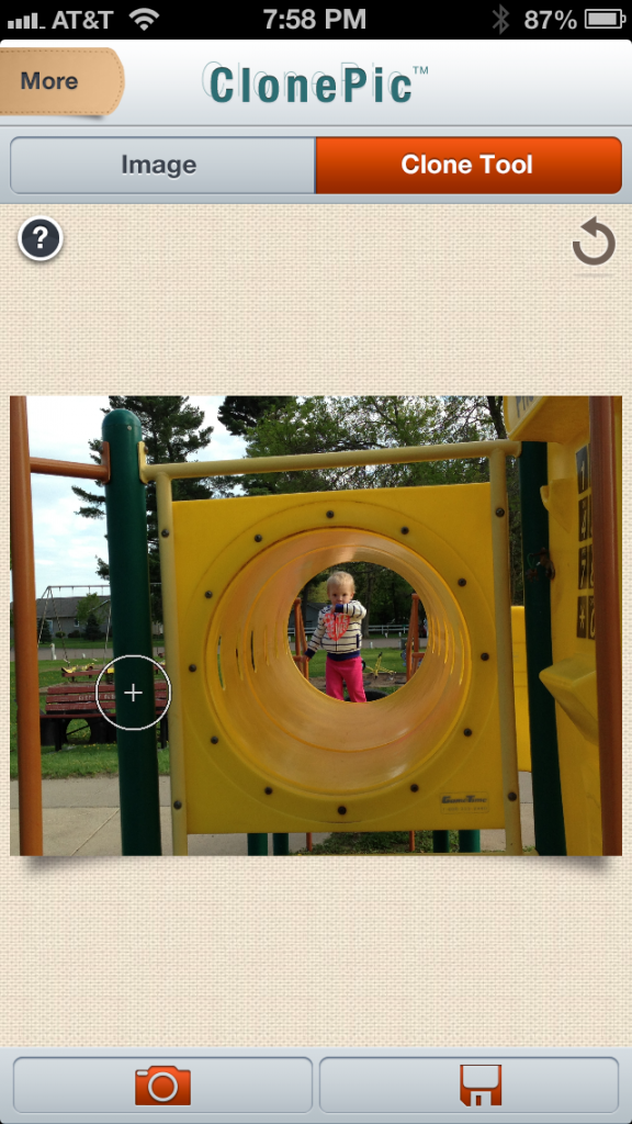 """The circular """"Cloning Tool"""".  This tool can be resized to clone large or small areas of the photo."""